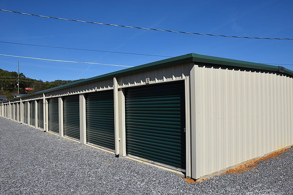 An angled view of green storage units at Volunteer Mini Storage