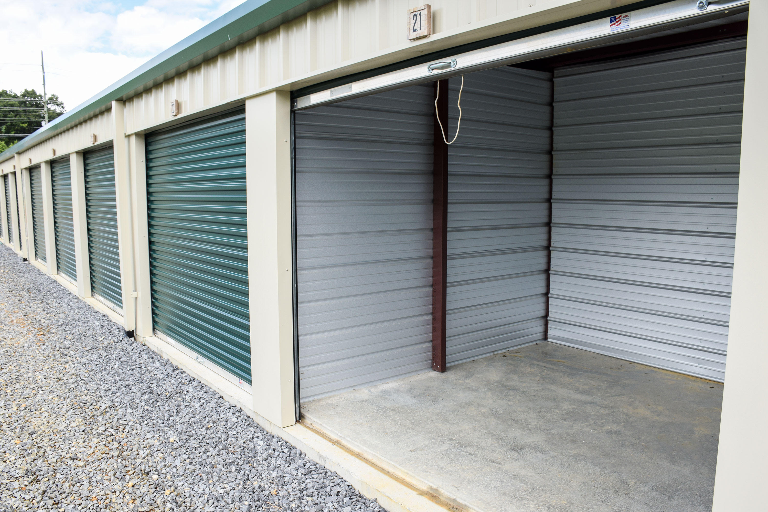 Open green self storage unit at Volunteer Mini Storage