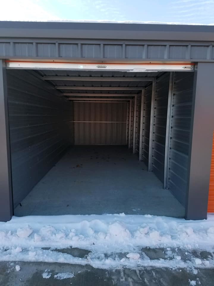 picture of storage unit with snow in front of door