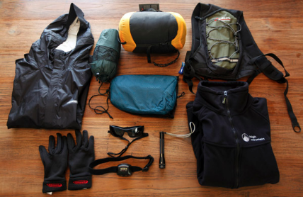 Recreational outdoor gear laid out on the floor