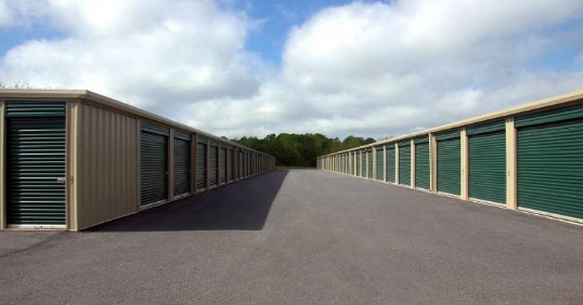Two rows of green and tan storage units