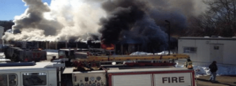Fire department responding to a fire at a storage unit facility