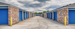 Two rows of brick storage units with blue doors