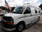 Class B motorhome with white paint