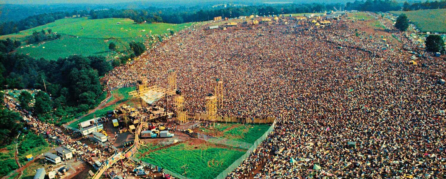 View of people at woodstock located in Bethel New York, one of the largest social gathering events of all times.