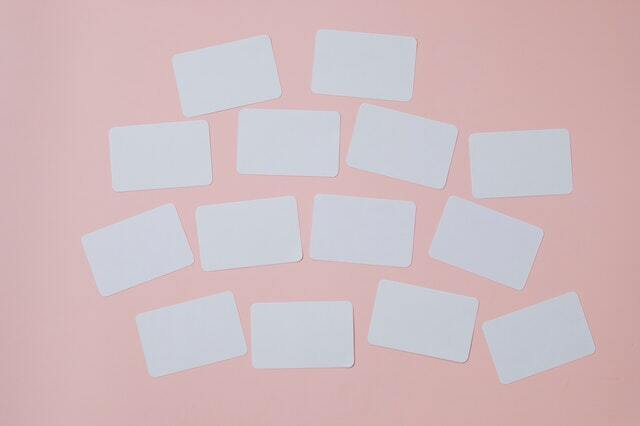 White labels on a pink background