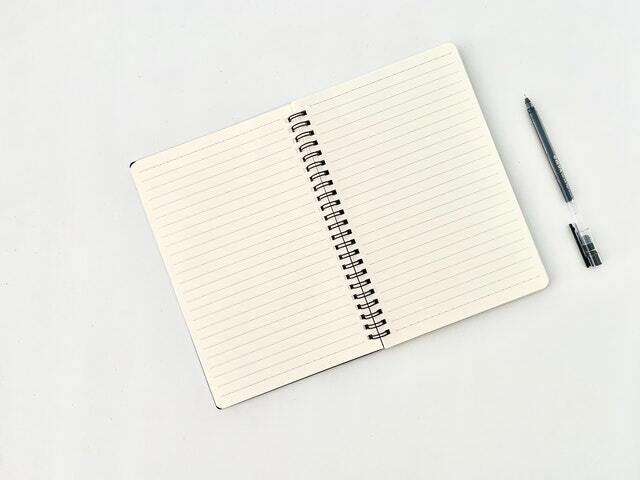 A notebook and a pencil