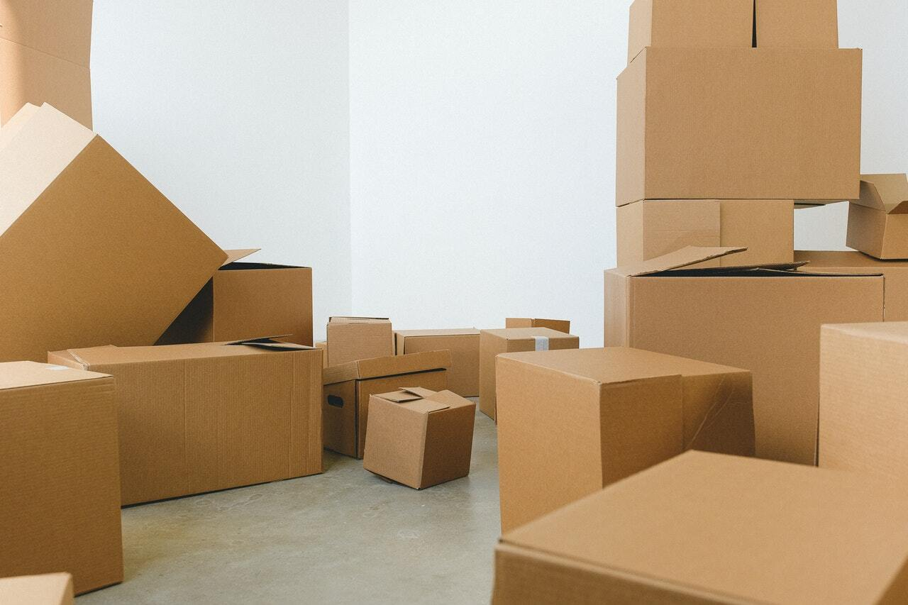 A storage unit filled with stacked cardboard boxes
