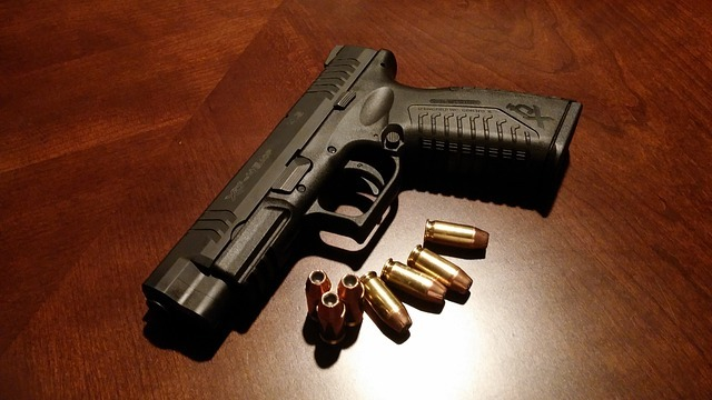 A gun and bullets symbolizing items you mustn't keep in your storage unit